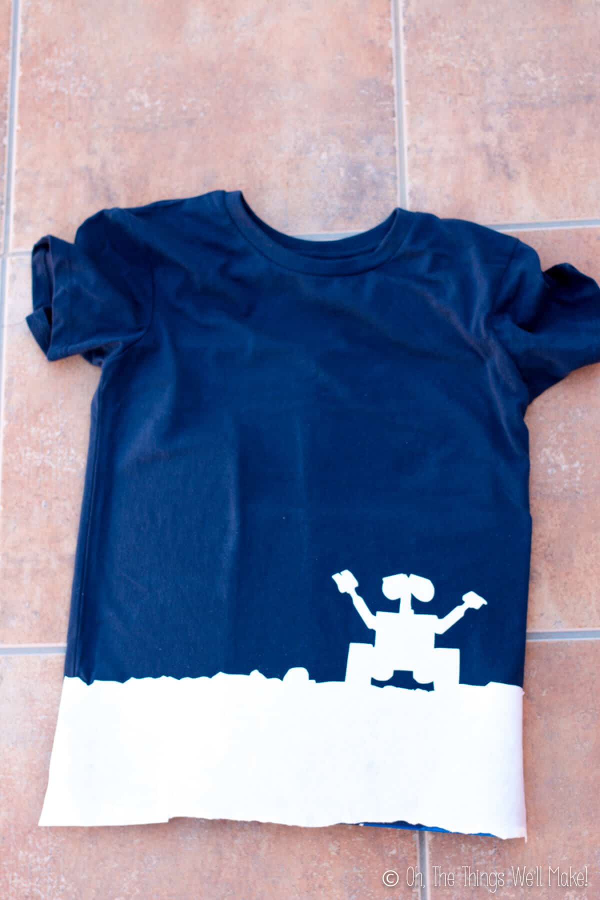 T-shirt with freezer paper stencil of Wall-E silhouette ironed onto the bottom.