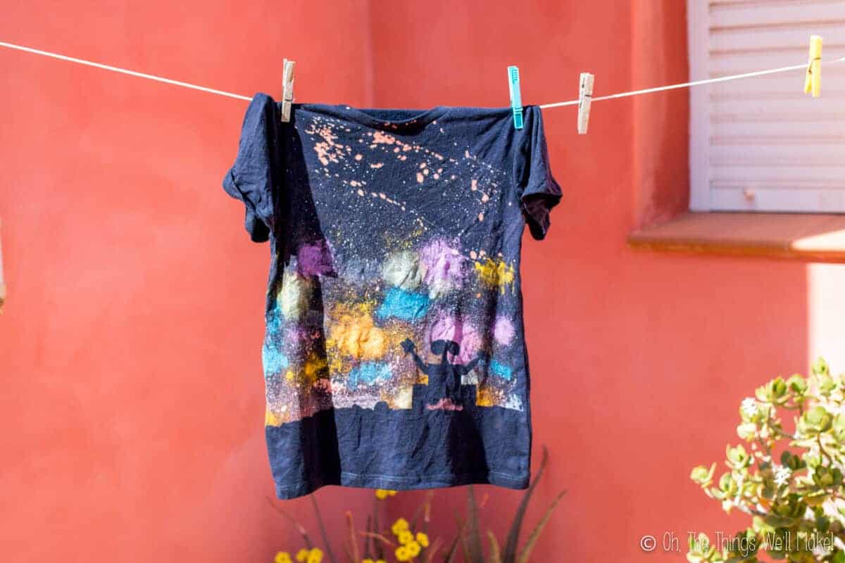 A newly finished galaxy Wall-E t-shirt after having been washed, hanging on a clothesline to dry