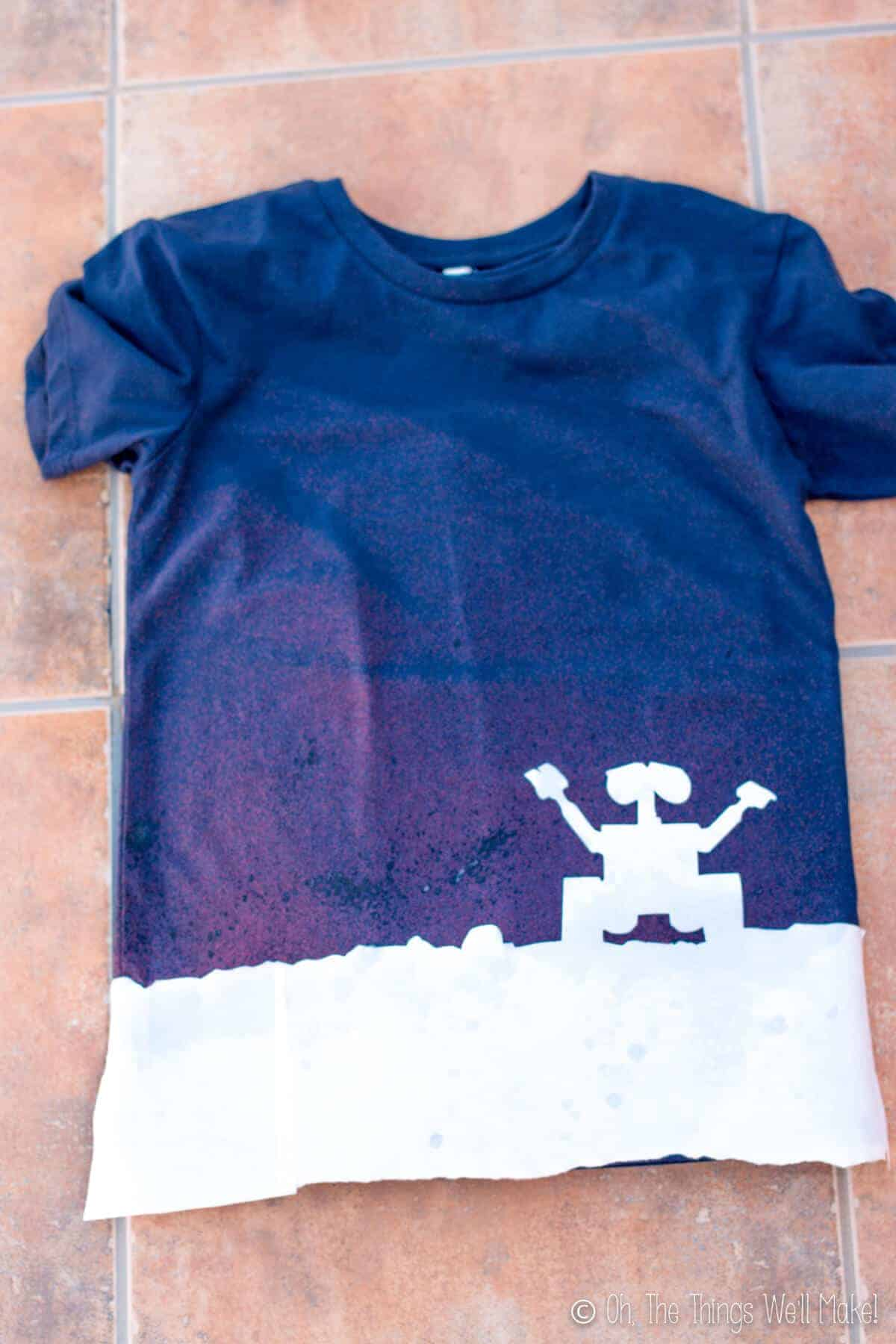 t-shirt with freezer paper Wall-E stencil after having been sprayed with bleach