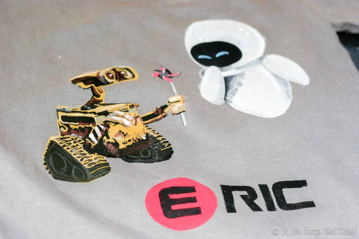 photo of t-shirt with painted Wall-E and Eve
