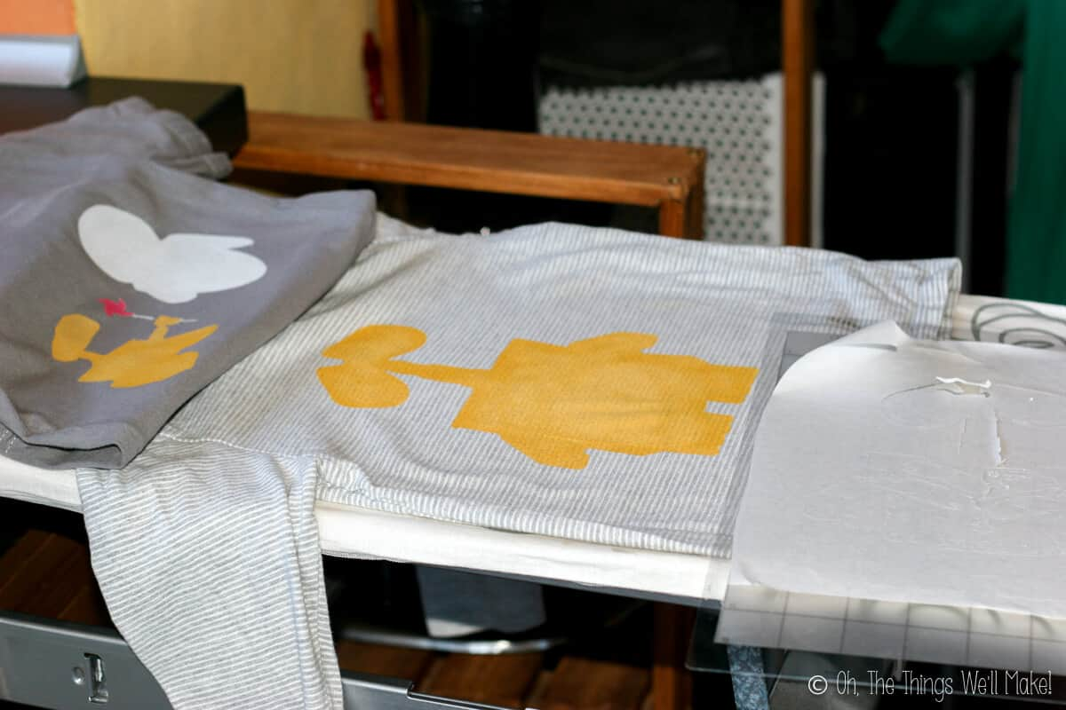 two Wall-E stencil t-shirts with the first layer of paint