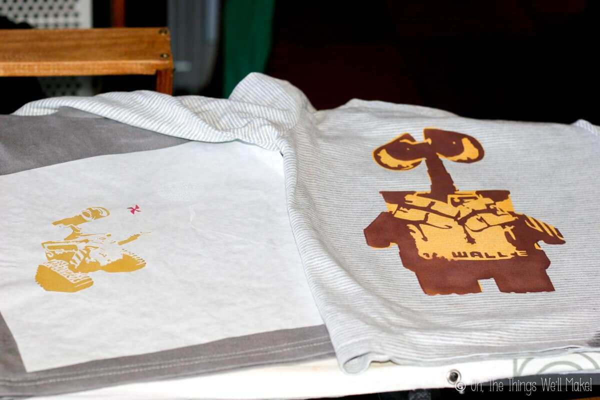 Both Wall-E stencil t-shirts. The one on the right with yellow and brown layers already painted.