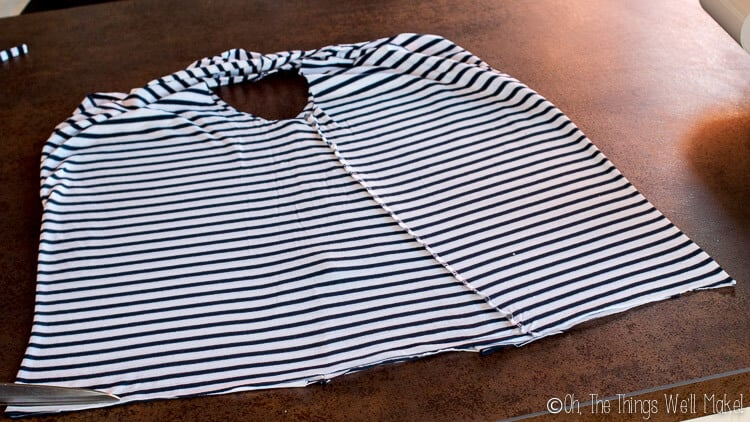 t-shirt flipped to line up the holes of the sleeves in the center.
