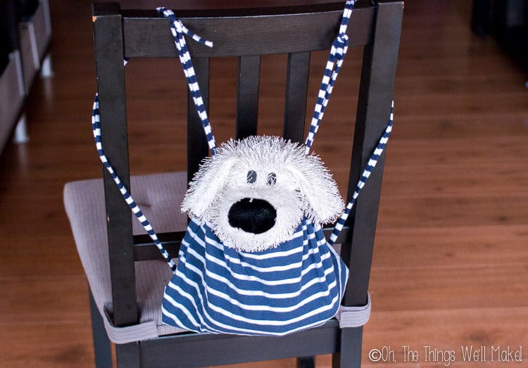 Homemade backpack from a kid's shirt hanging on a shirt with a stuffed animal inside