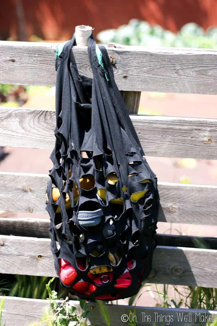a produce style bag made from a t-shirt with slits cut into it.