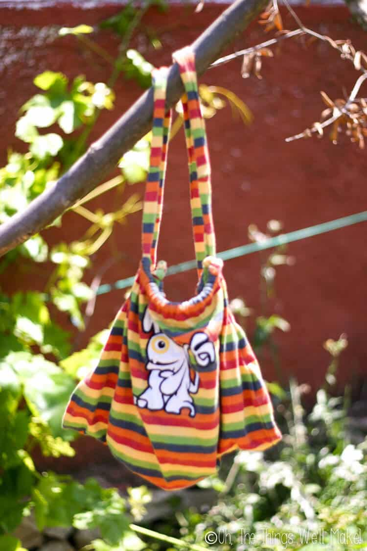 backpack made from a t-shirt hanging from a tree