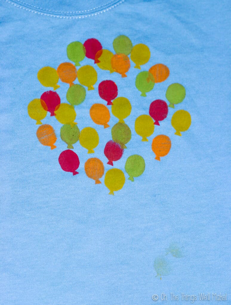 balloons shirt with more balloons of different colors stamped on it.