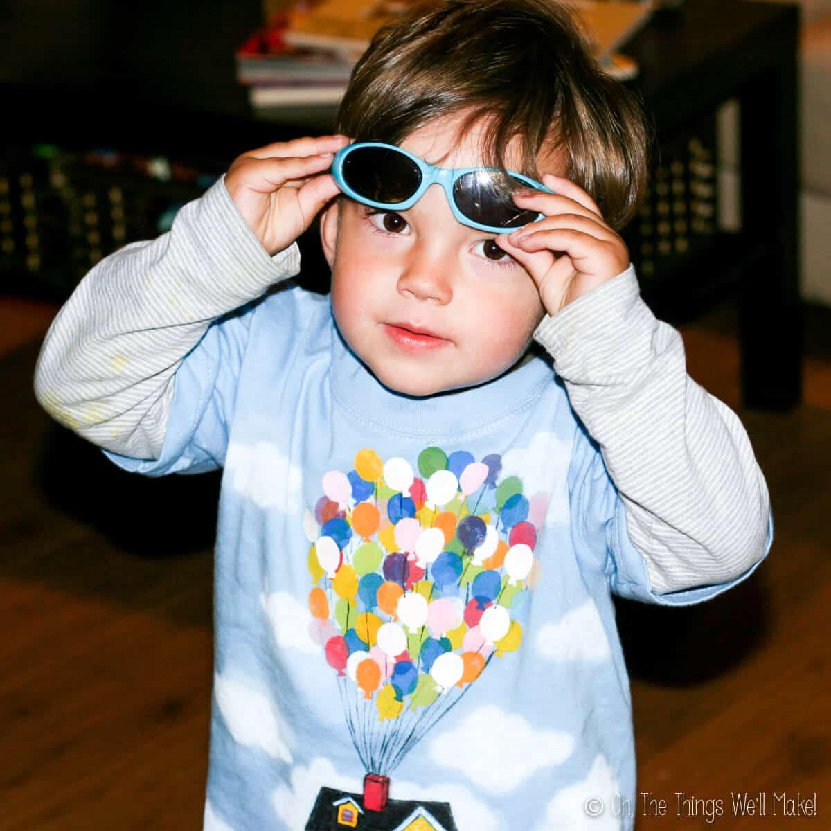 boy wearing homemade Up balloons shirt
