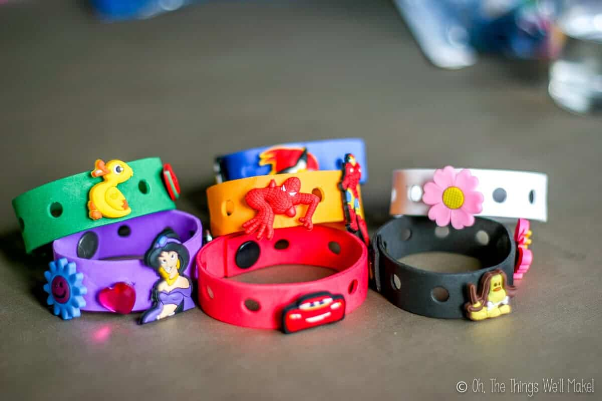 homemade craft foam bracelets in several colors with Crocs charms (Jibbitz) on them