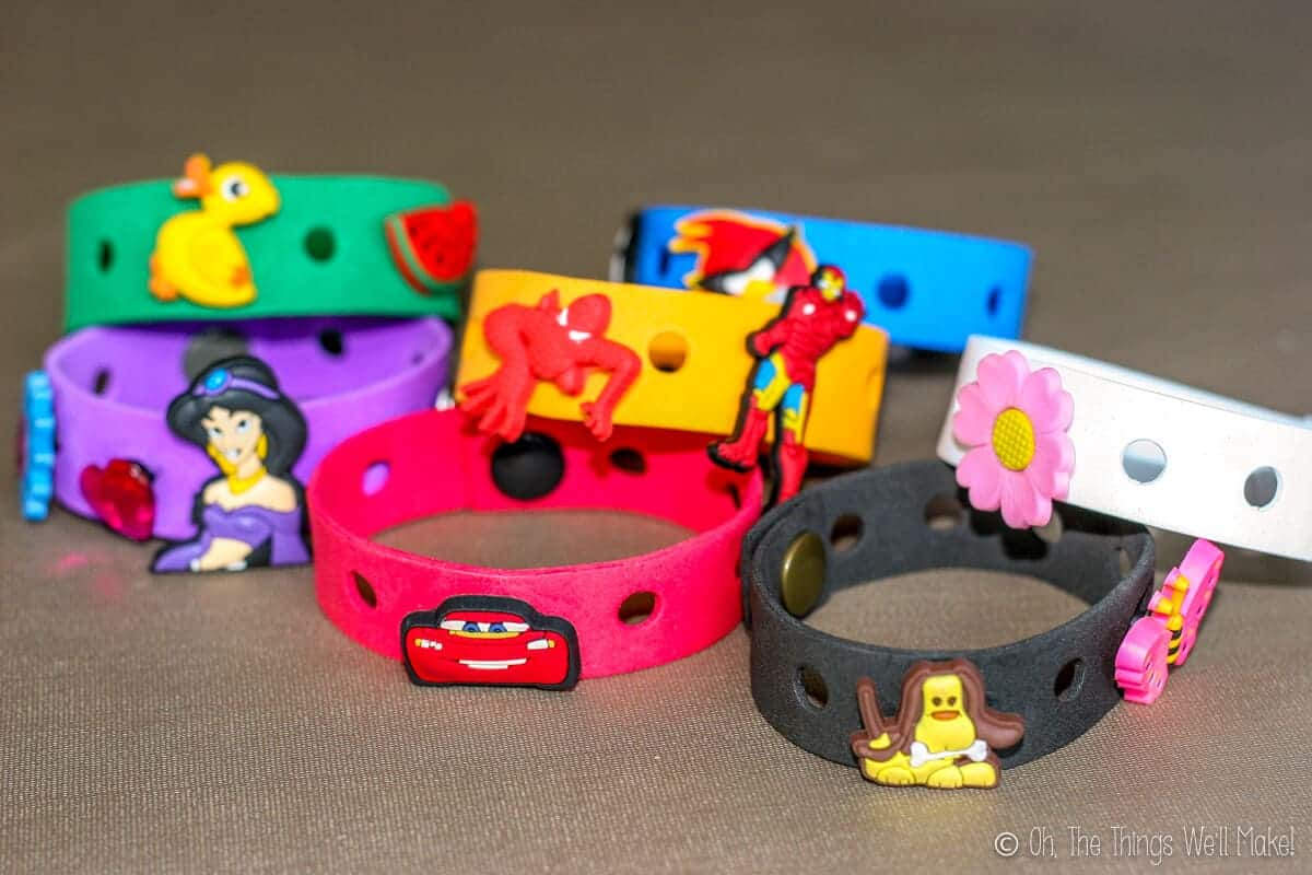 6dfa2d67598b3 homemade craft foam bracelets in several colors with Crocs charms (Jibbitz)  on them