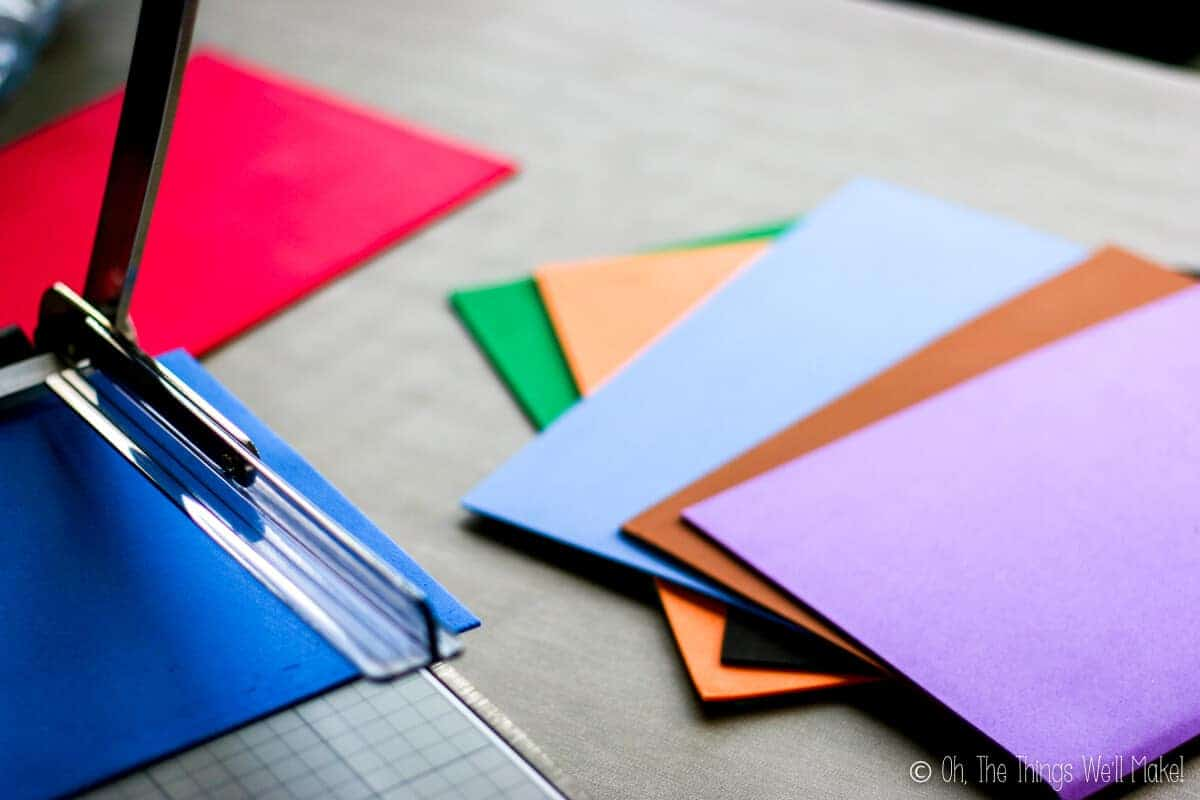 craft foam being cut into strips by a paper cutter