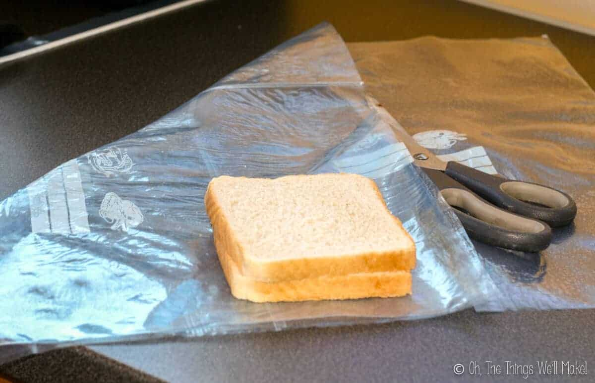 a sheet of fused plastic on a counter with some sandwich bread on top