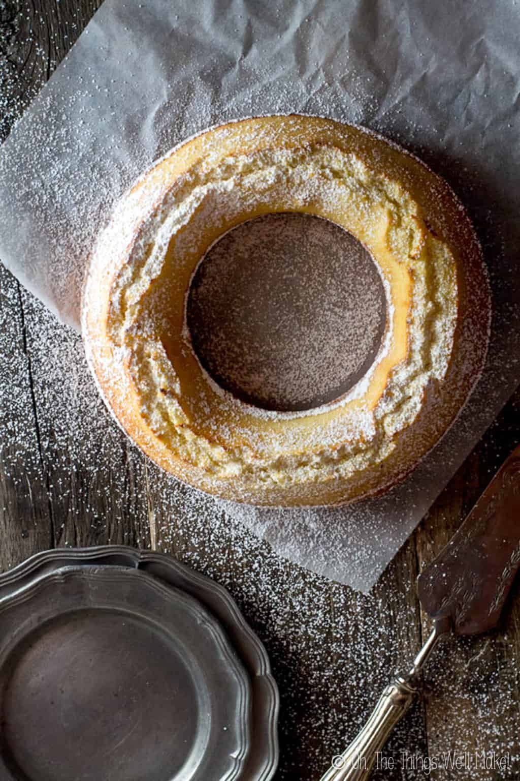 Overhead view of a circular ciambella allo yogurt, an Italian lemon breakfast cake.