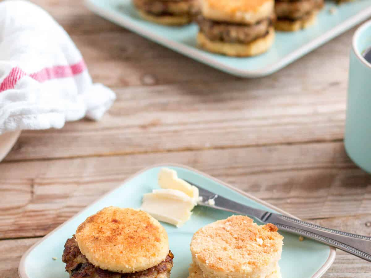Delicious sausage patties in between homemade sausage biscuits with butter on the side.