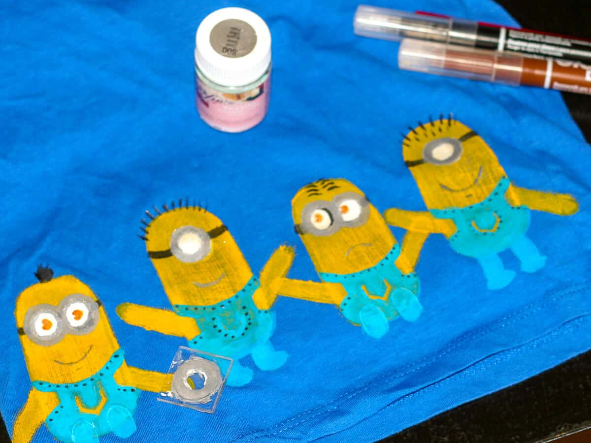Minion stamped paint on blue fabric