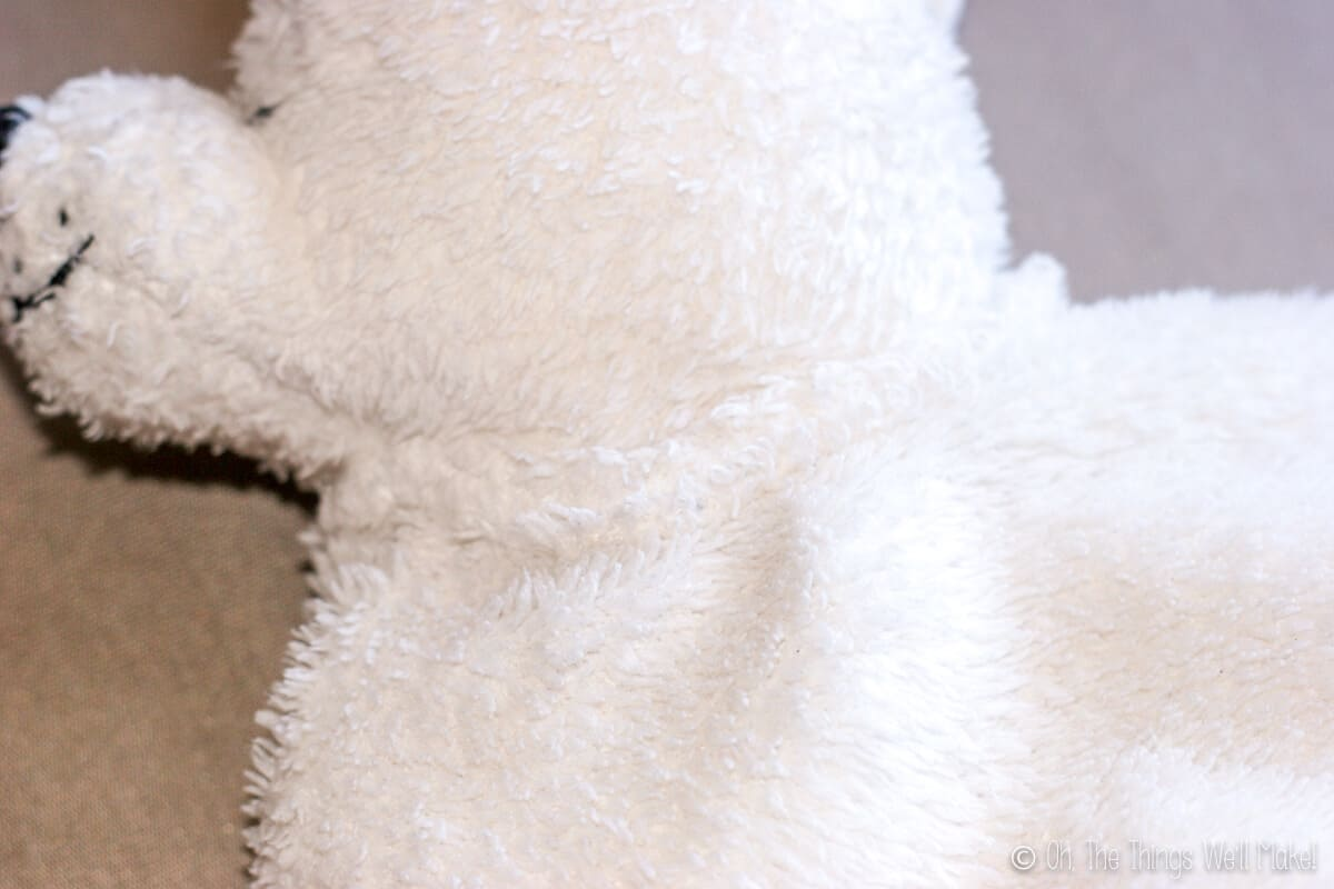Close up of the neck of the blanket to show how the stuffed animal head was sewn on.