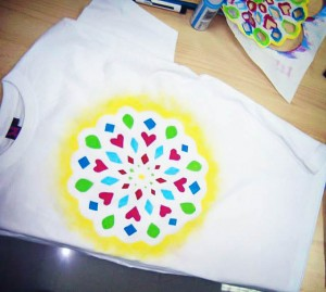 A t-shirt with a hand-painted mandala design