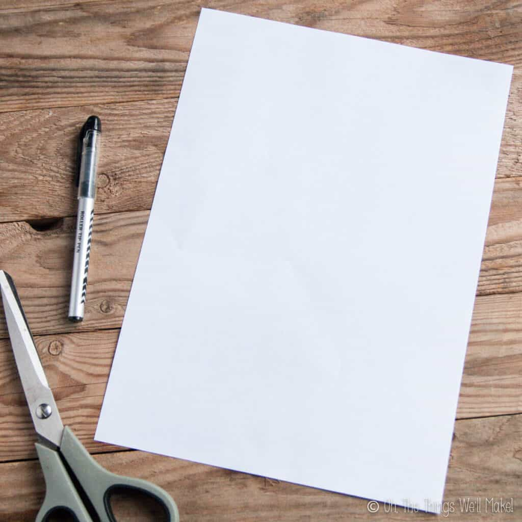 A white piece of paper on a wooden background.