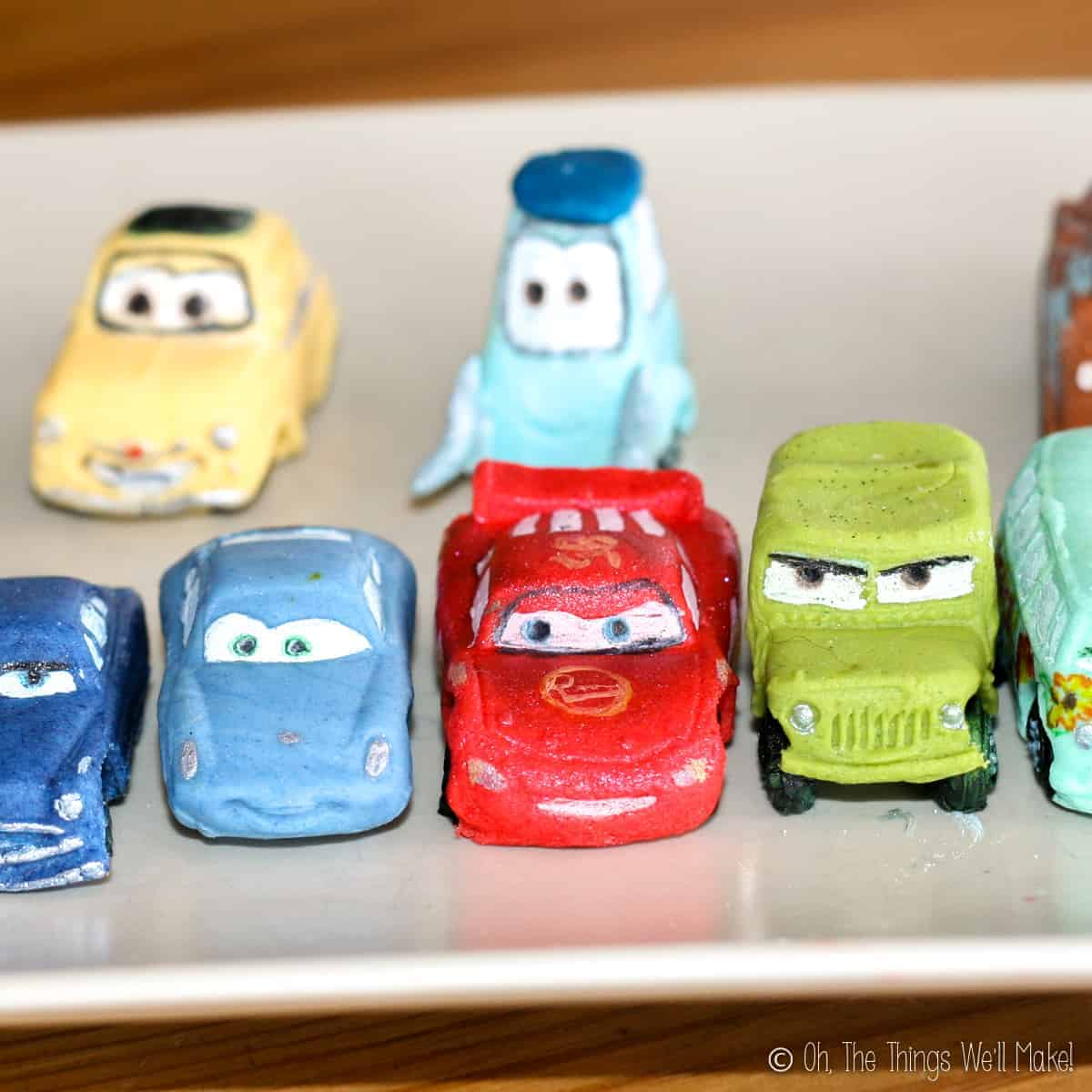 A plate with several fondant cars on it
