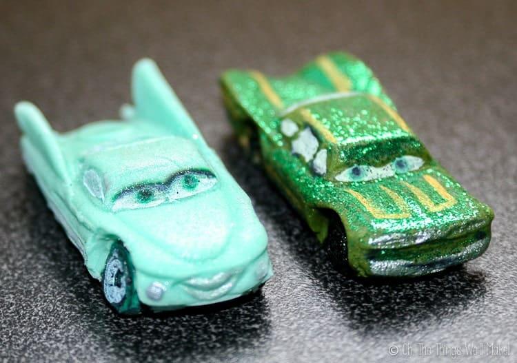 A closeup of 2 fondant cars: Flo and Ramone