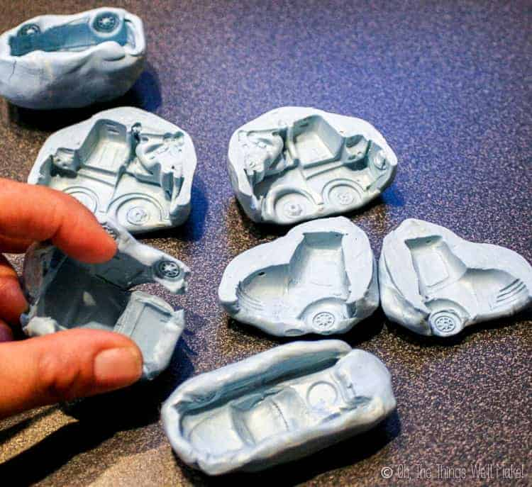 Several different homemade silicone molds of different characters from the Cars movies