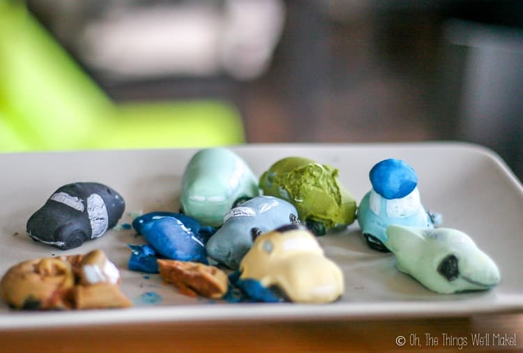A plate of fondant cars that have puffed out and deformed in shape.