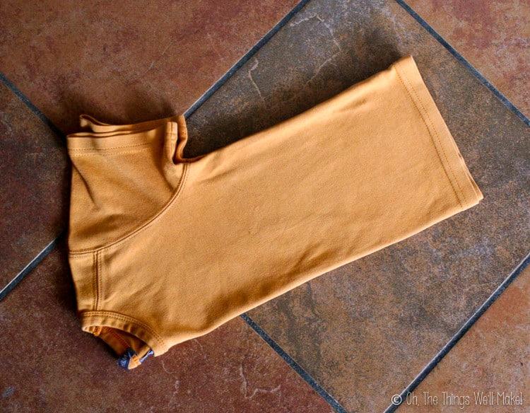 An orange t-shirt folded in half
