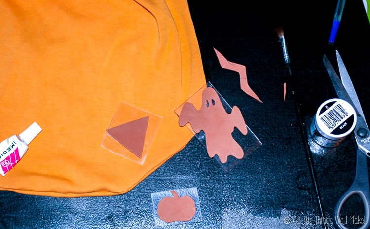 gluing the craft foam Halloween shapes onto clear plastic to make fabric stamps