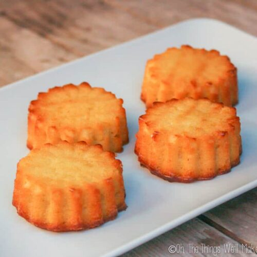 Four mini tartas de Santiago, baked in silicone muffin molds, on a plate