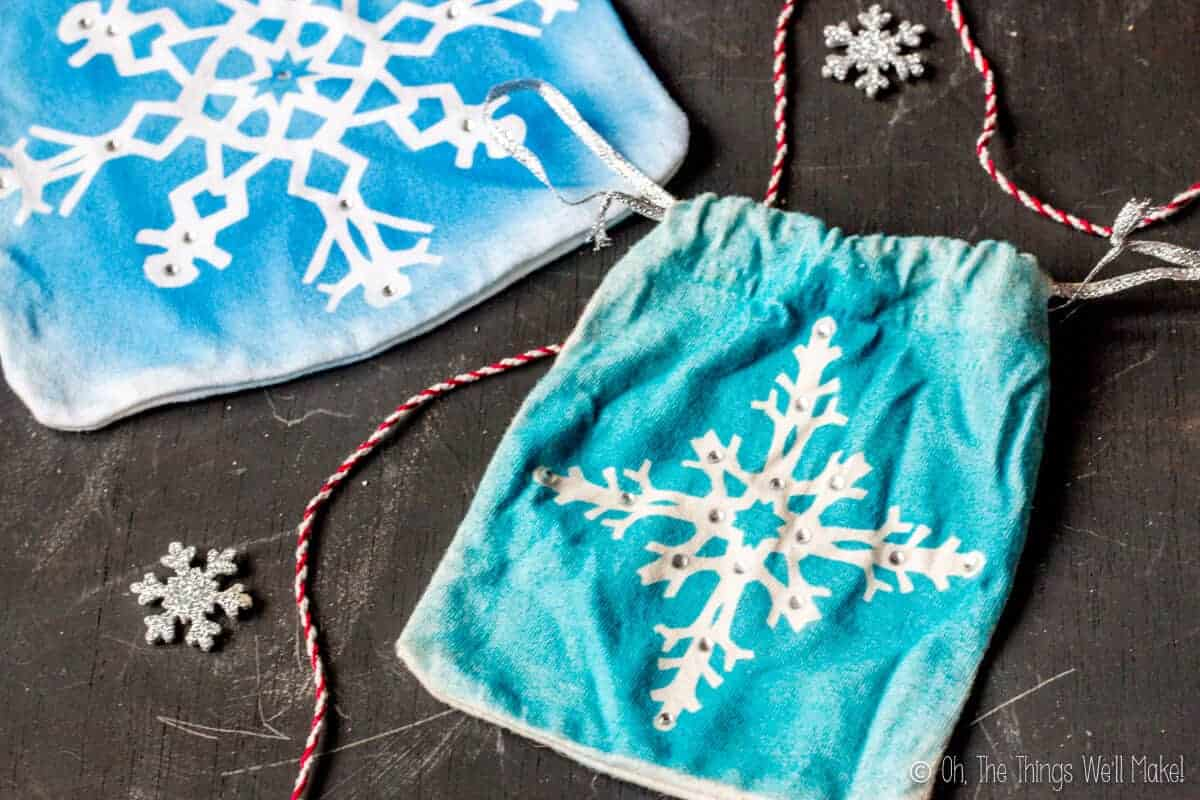 Closeup of two homemade snowflake gift pouches