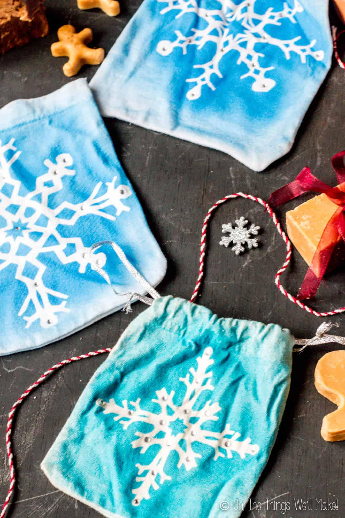 Photo from above of 3 snowflake gist pouches.