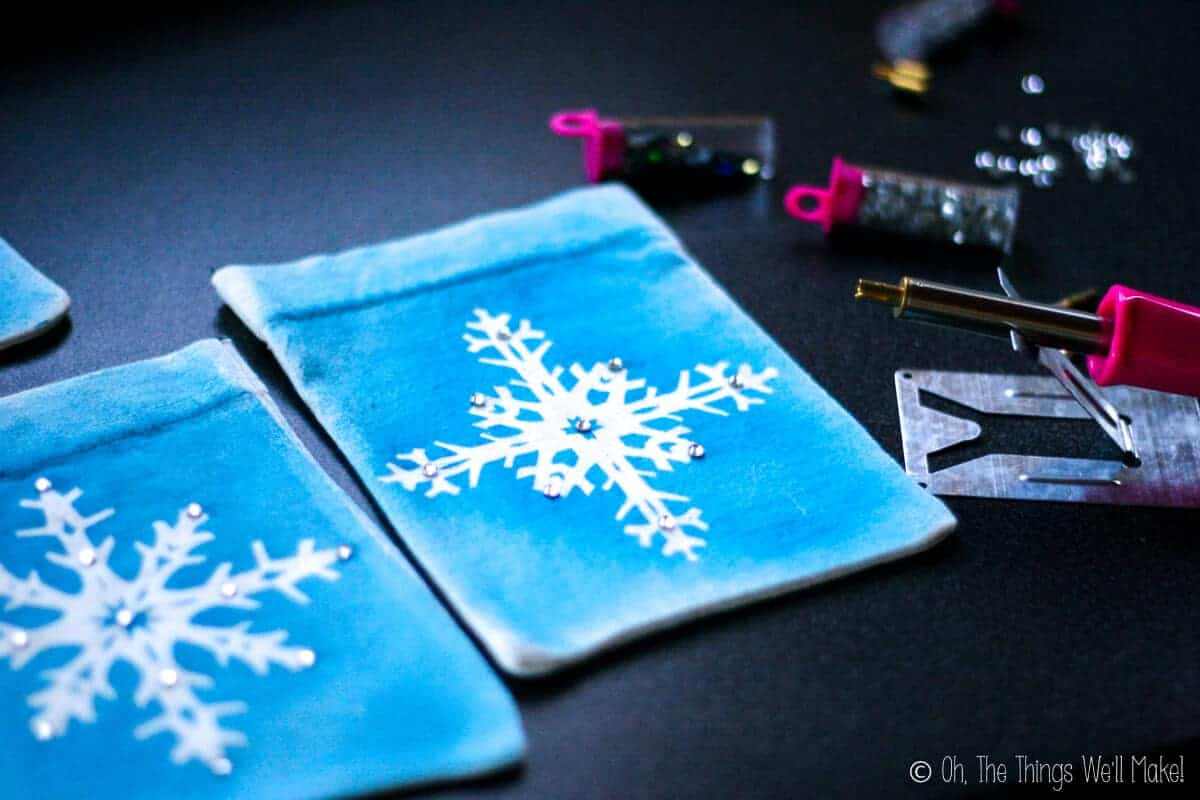 Embellishing the snowflake pouches with rhinestones