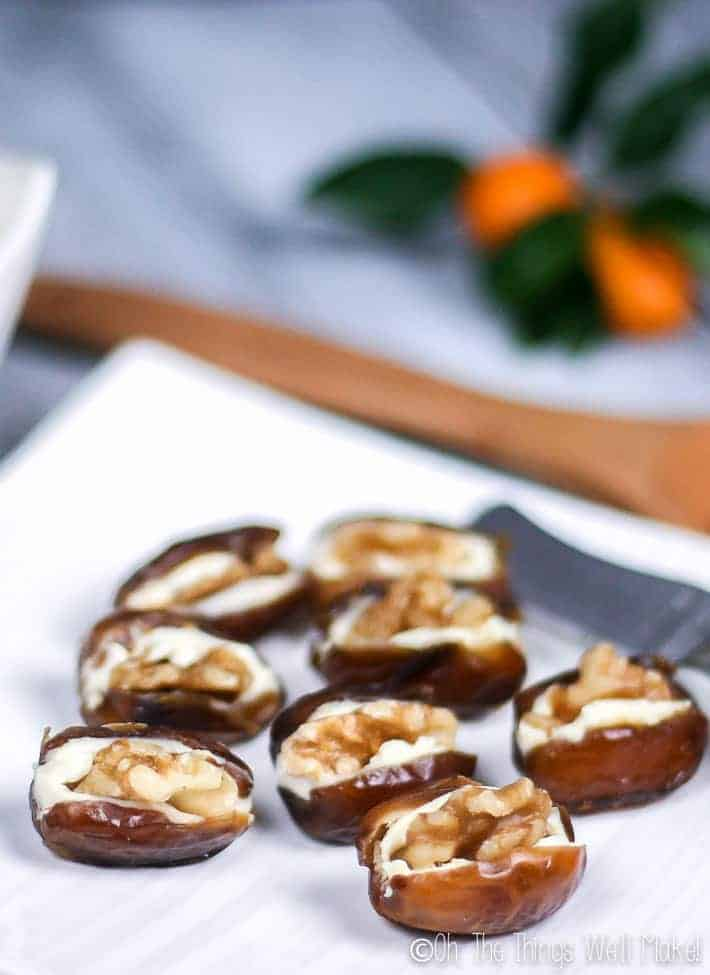 Closeup of 8 cheese stuffed dates on a plate