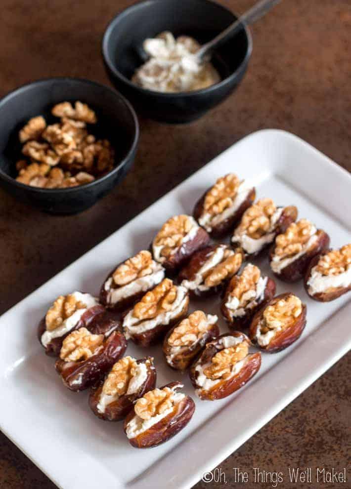 Overhead view of cream cheese walnut stuffed dates on a platter