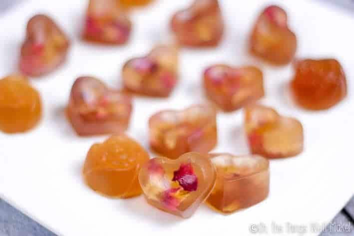 Closeup of rose petal gummies on a plate