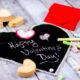 A foldable, portable heart-shaped chalkboard made from chalkboard fabric