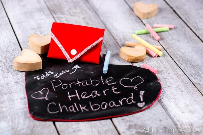 Two foldable chalkboard hearts. One open and one folded shut.