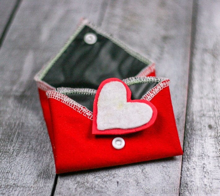 Folded up chalkboard heart with felt and craft foam eraser on top.