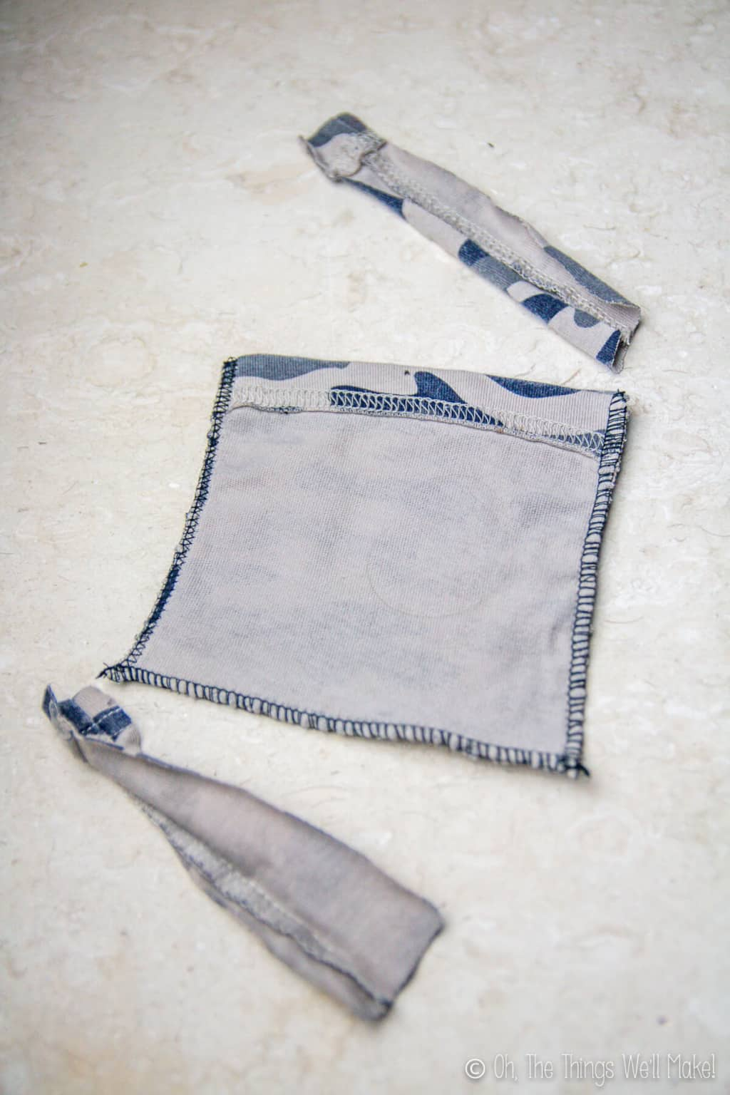 A cut sleeve laid inside out with the bottom hem sewed.