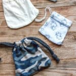 3 drawstring pouches made form the sleeves of baby clothes