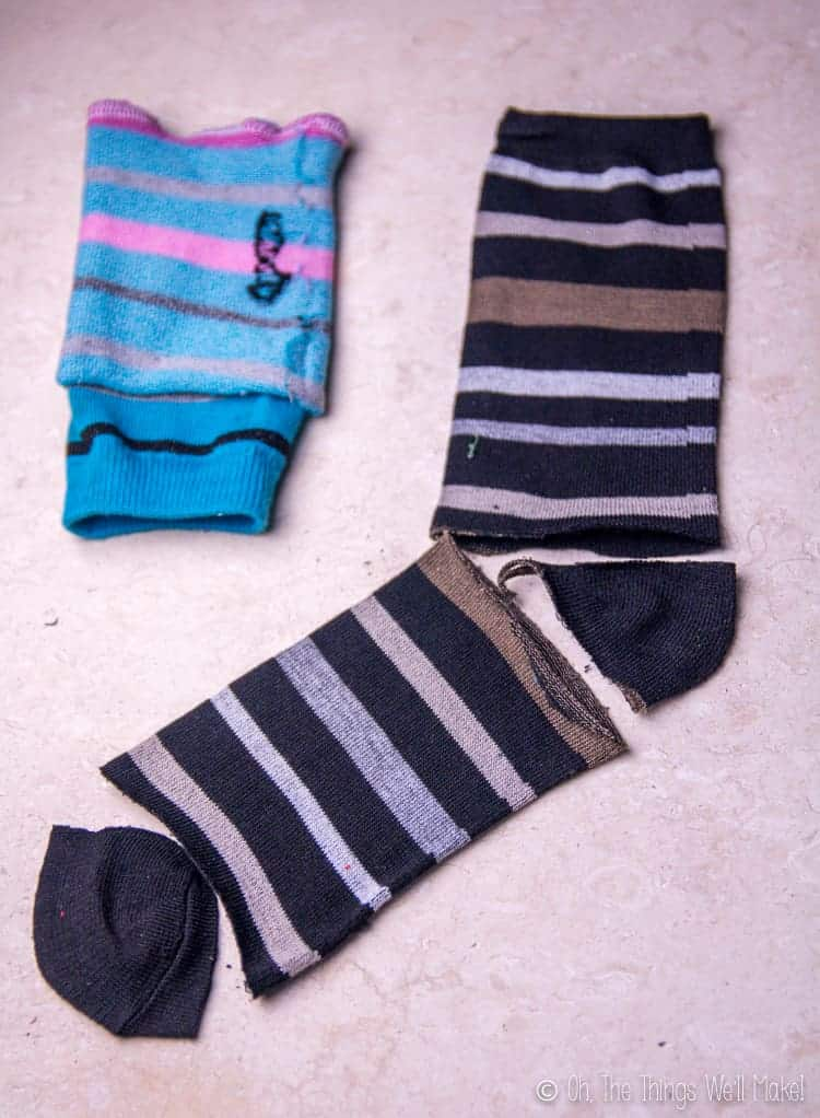 Photo of a black sock whose heel and toe areas have been cut out .