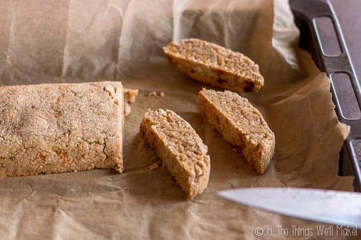 Slicing the baked biscotti to get them ready for their second baking