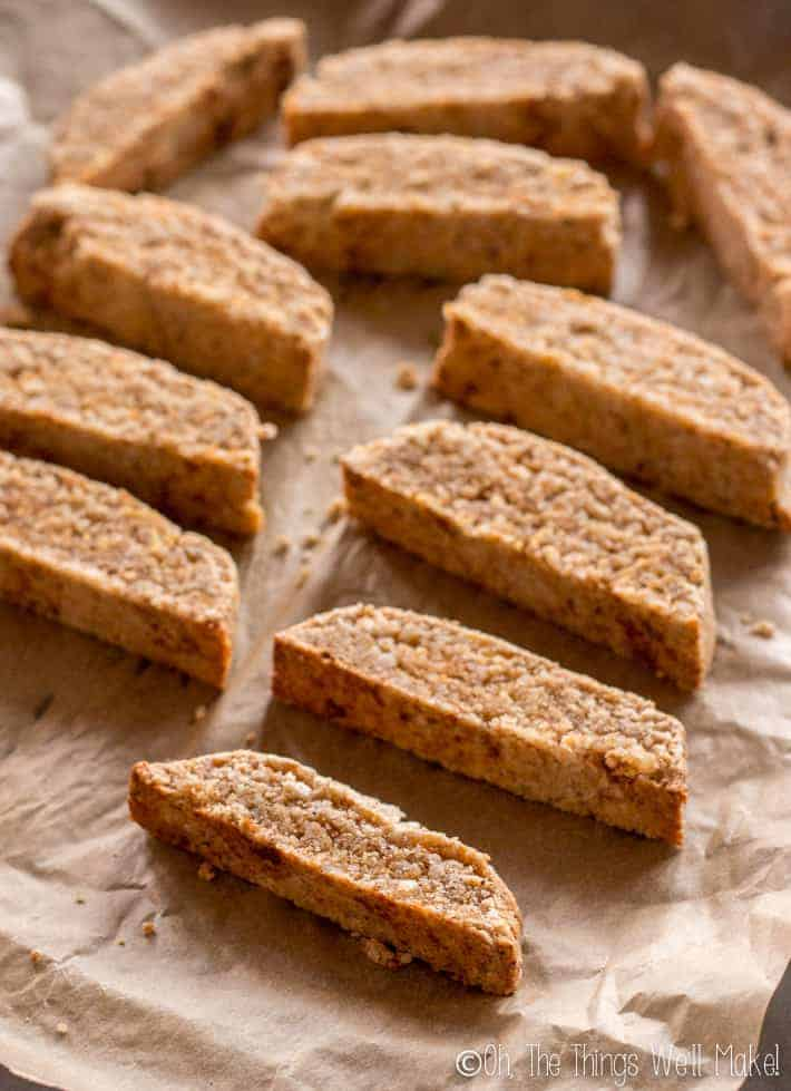 Sliced biscotti on a baking sheet, ready for their second baking.