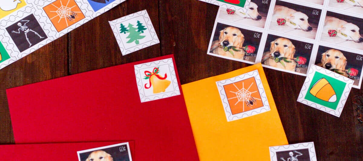 A variety of homemade holiday lick-and-stick stamps- some for Halloween, some for Valentine's Day, and some for Christmas. Some have been stuck to envelopes.