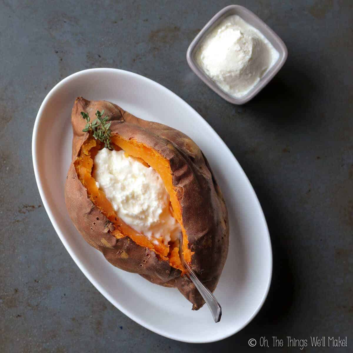 Overhead view of homemade kefir sour cream in a baked sweet potato