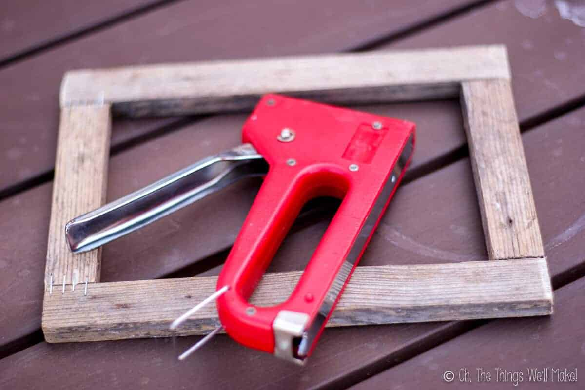 A wooden frame and a stapler
