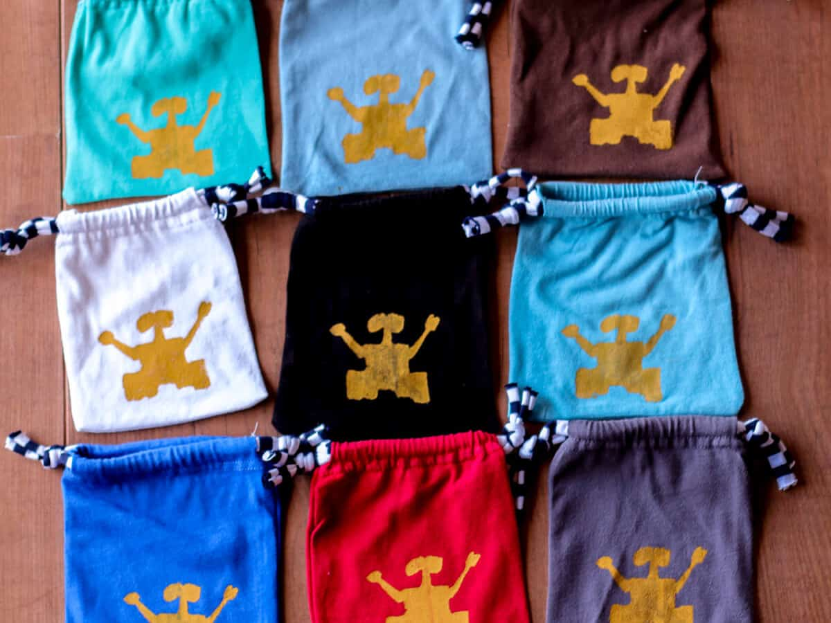 Overhead view of 9 cloth pouches with Wall-E silk screened on them