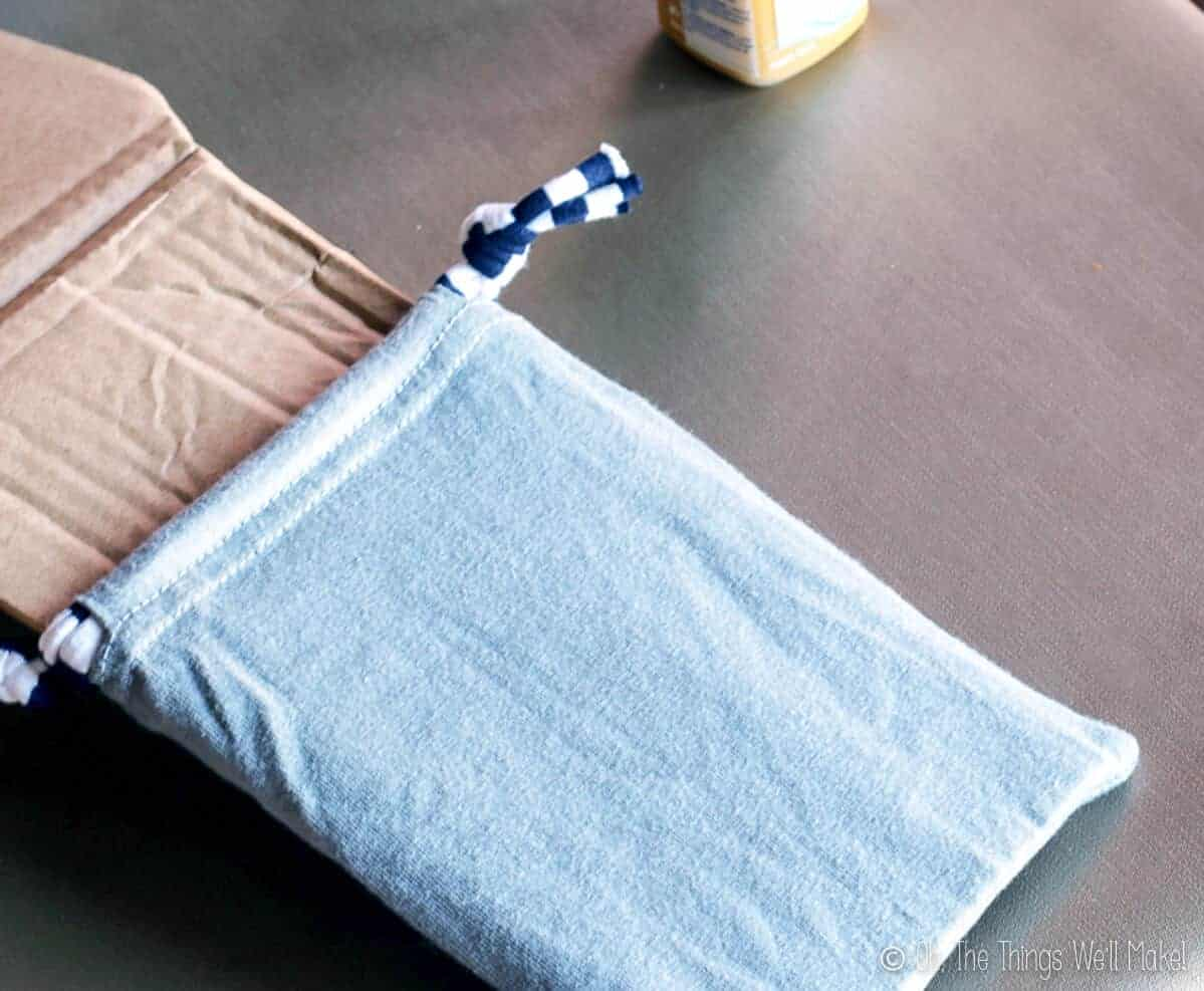 A cloth pouch with cardboard inside it
