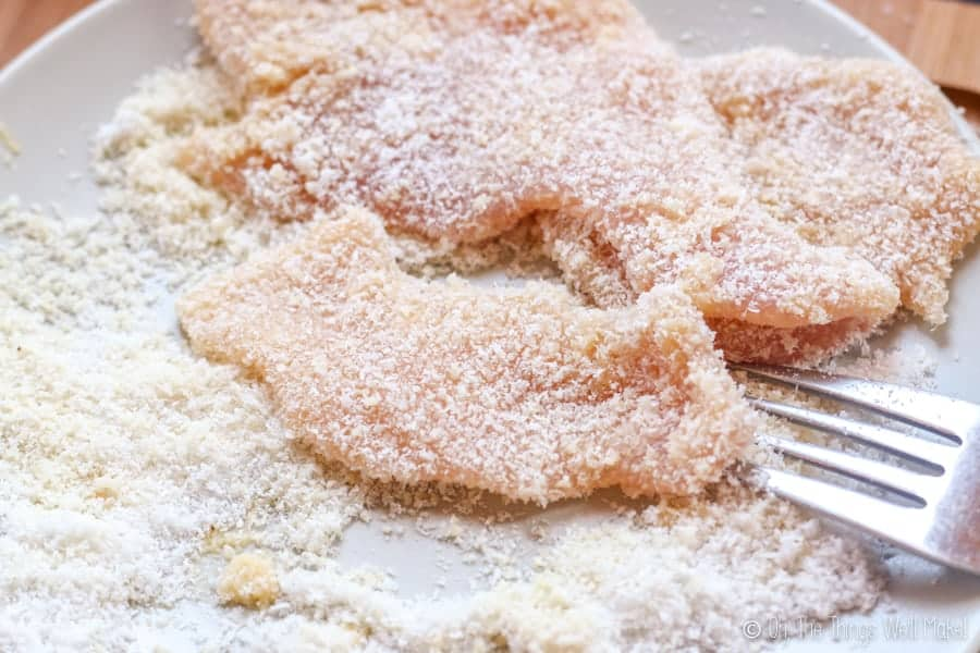 Coating a bat shaped chicken nugget with a flour mixture