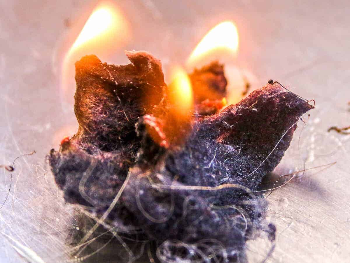 Close-up of dryer lint fire starters on fire.